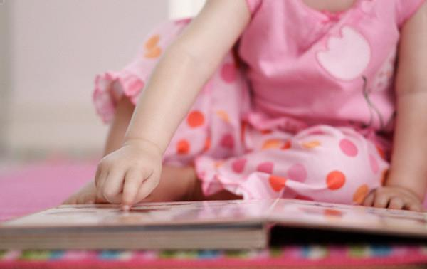 Toddler reading picture book